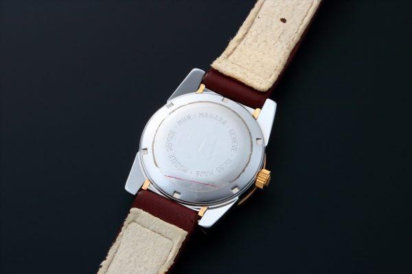 MHR Mahara Date Tutone White Dial Watch - Baer & Bosch Auctioneers
