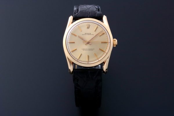Rolex Bombay 14k Yellow Gold Watch 1010 - Baer & Bosch Auctioneers