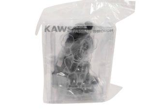 KAWS Companion Vinyl Figure Passing Through Black - Baer & Bosch Auctioneers