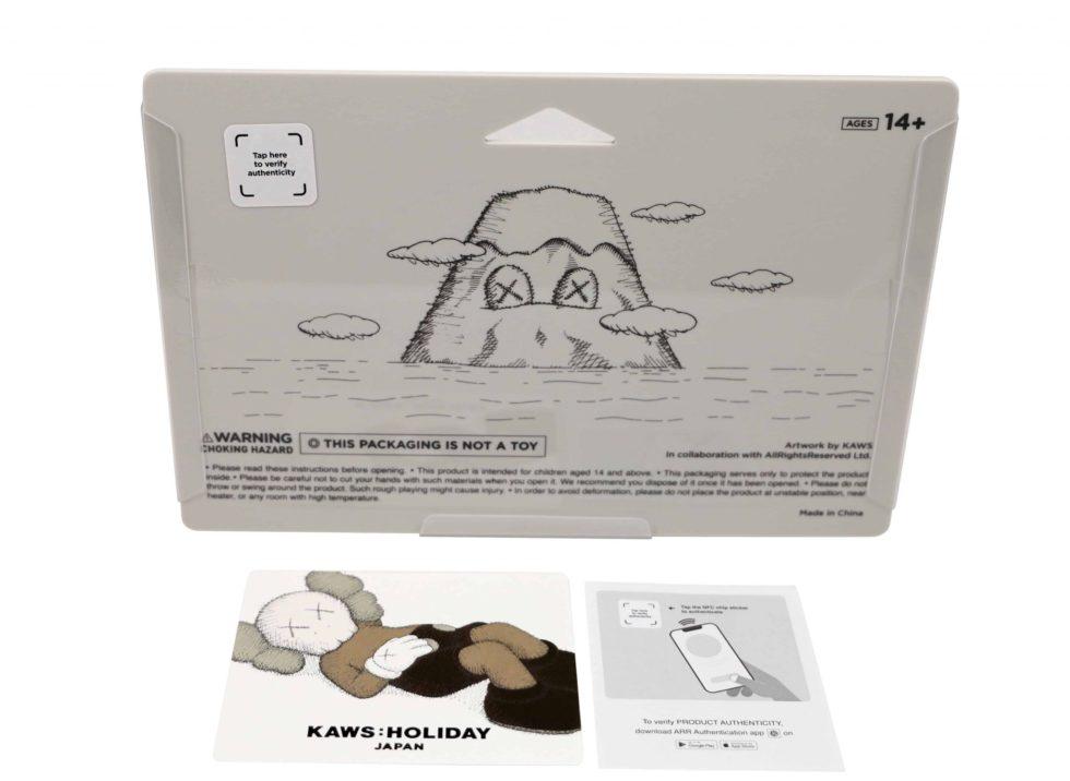 Lot #5184 – KAWS Holiday Japan Vinyl Figure Grey Art Toys KAWS