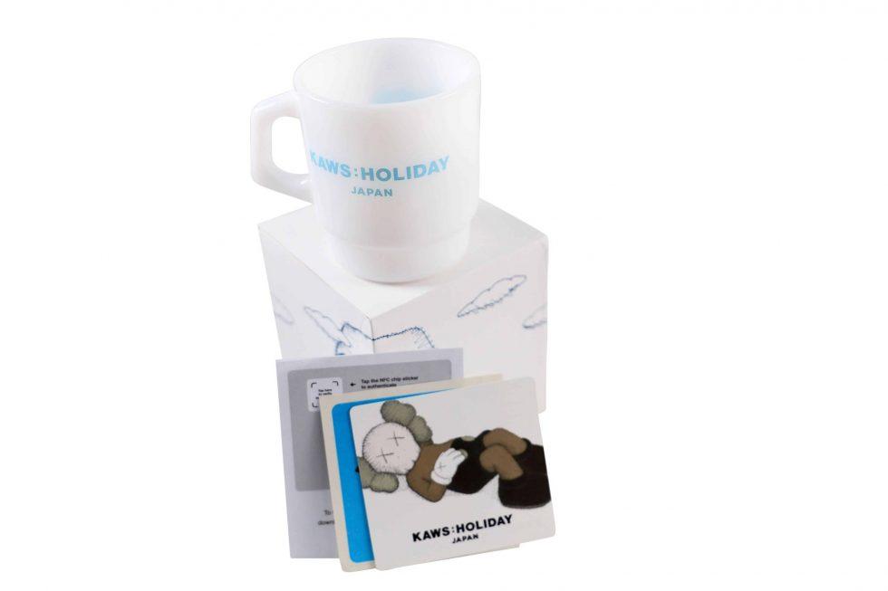Lot #7407 – KAWS Holiday Japan Mount Fuji Fire King Mug Blue Various [tag]
