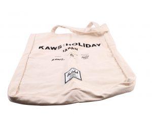 Lot #7094 – KAWS Holiday Japan x Herschel Tote Bag Japan Exclusive Various [tag]