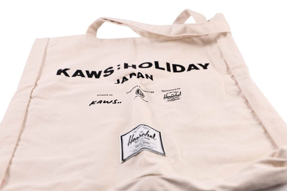 Lot #7094 – KAWS Holiday Japan x Herschel Tote Bag Japan Exclusive Various [tag]