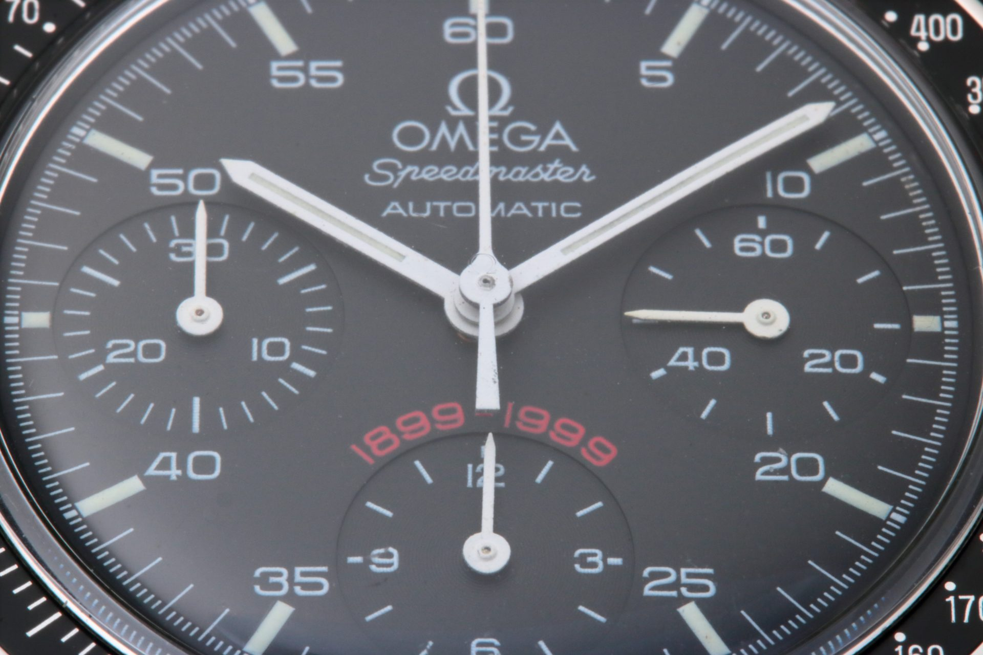 Omega Speedmaster A.C. Milan 1899 - 1999 dial close up of the 3810.51.41. Note the original Omega Hesalite crystal indicated by the Omega logo in the center of the crystal.