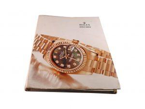 Lot #10274 – Rolex 2002 – 2003 Master Dealer Watch Catalog Collector's Bookshelf [tag]