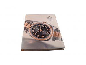 Lot #10275 – Rolex 2005 – 2006 Master Dealer Watch Catalog Collector's Bookshelf [tag]