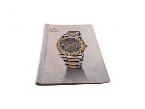 Lot #10283 – Rolex 2009 – 2010 Master Dealer Watch Catalog Collector's Bookshelf [tag]