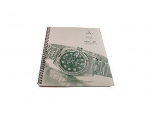 Lot #10285 – Rolex 2002 Master Dealer Watch Price List Catalog Collector's Bookshelf [tag]