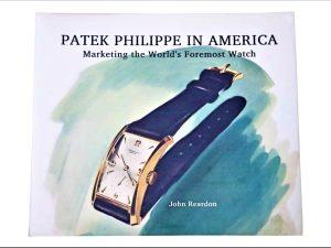 Lot #11467A – Patek Philippe in America Book John Reardon SIGNED Collector's Bookshelf Patek Philippe in America Book